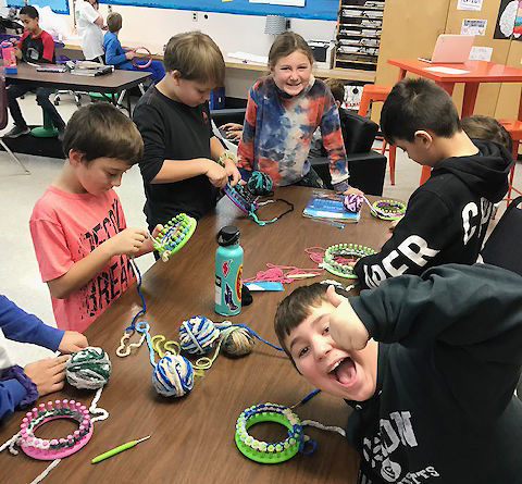 Thomas Fleming students use looms to knit for young cancer patients