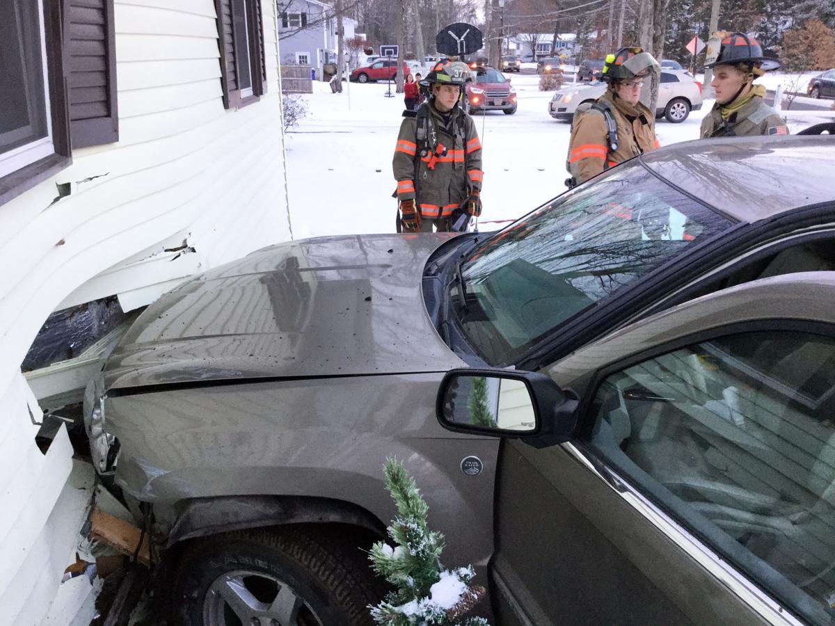 Vehicle crashes into West Street residence