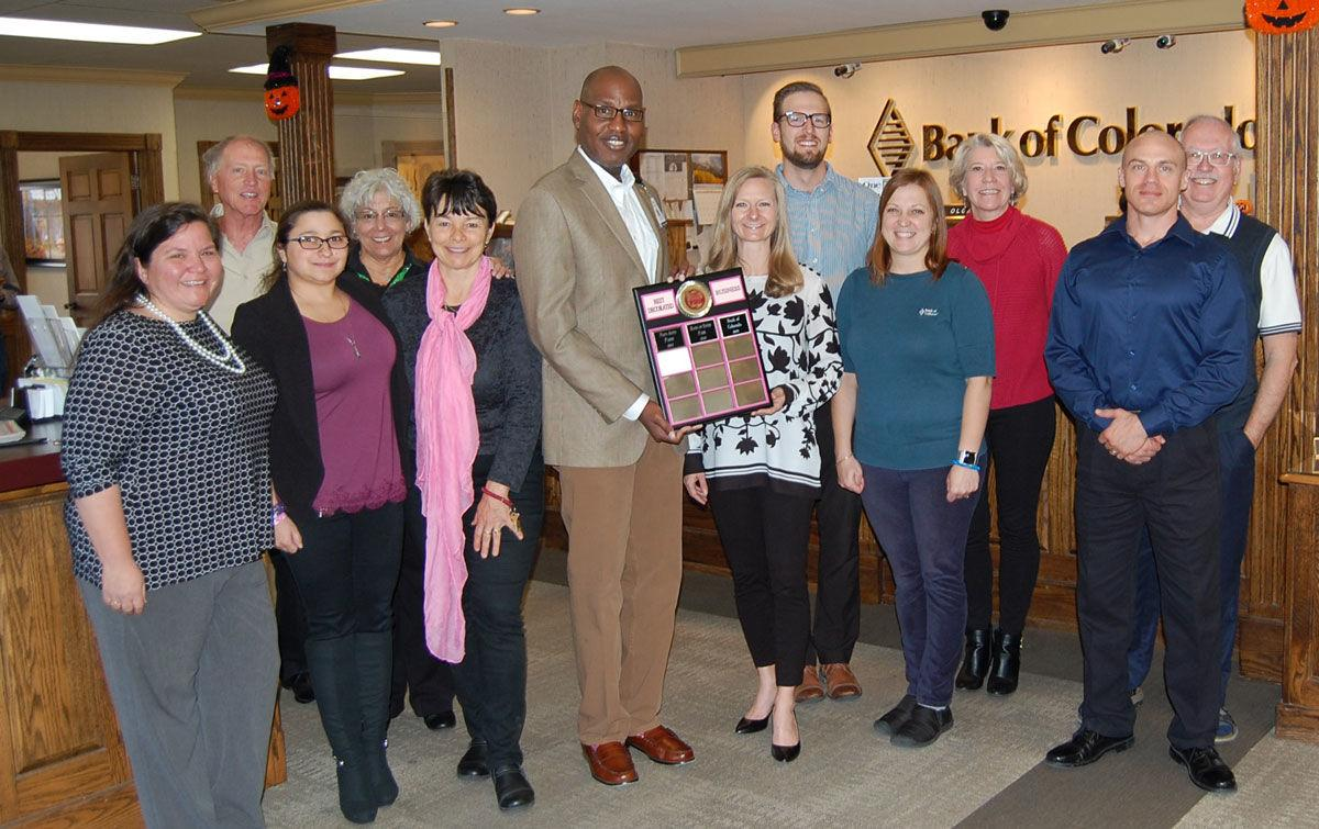 Kevin Mullin of Estes Park Health Foundation Presents Plaque to the Staff at Bank of Colorado.