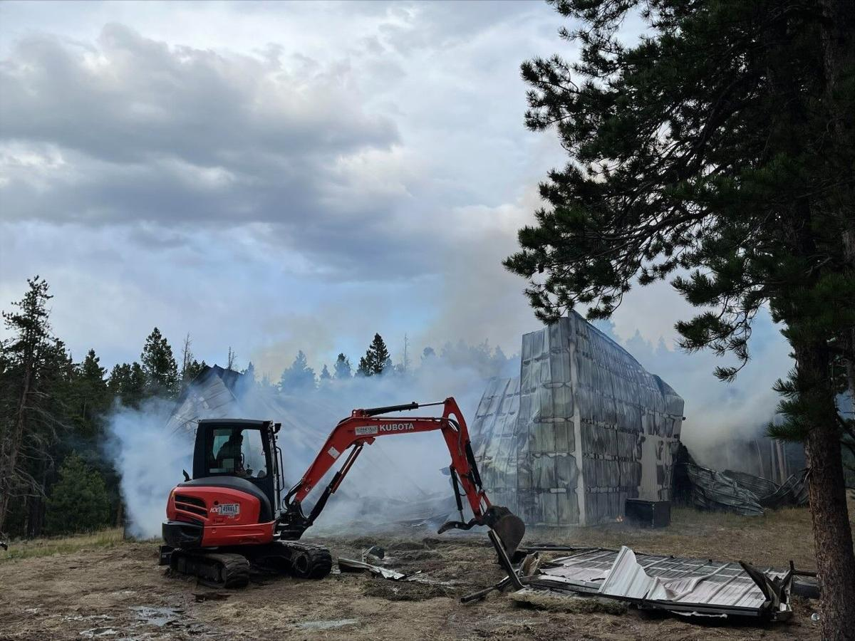Excavator working on collapsed metal hay barn building September 18 2021 Courtesy Rocky Mountain National Park.jpg