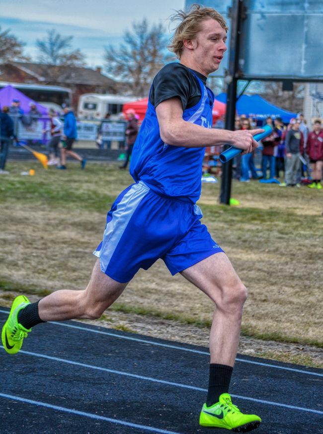 Tristan Gibson runs in the relay.