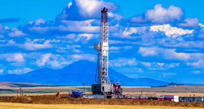 DeeThree Rig with Montana Sweetgrass Hills in the background