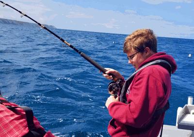Trever Severinsen fishing off the coast near Mahia, New Zealand.