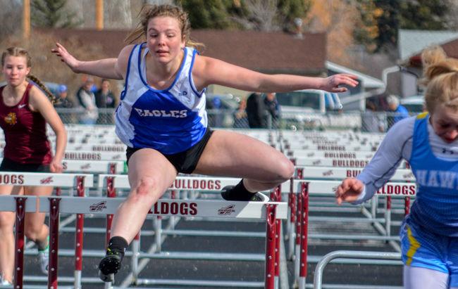 Cheyenne Maddox runs in the 100 meter hurdles.