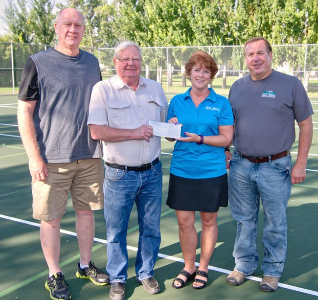 Sun River Electric Co-Op Donates Golf Tourney Proceeds To Tennis Court Project