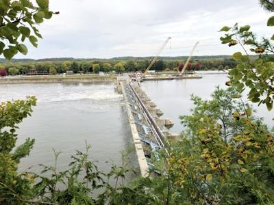 Barges could begin rolling on Illinois River next month