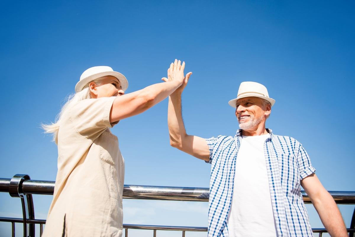 older couple high five