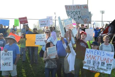 Protesters and counter protesters outside Potomac Nationals stadium April 13