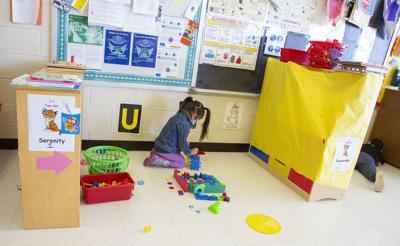 Head Start child with blocks