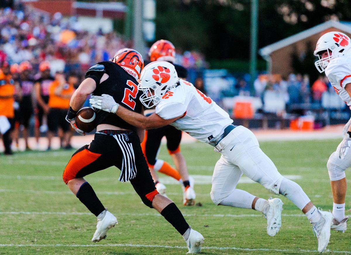football_Brentsville vs Kettle Run-3_KRHS Peyton Mehaffey tackles BDHS Bryce Jackson_20210910.jpg