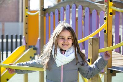 Cute preteen age girl in sunny day
