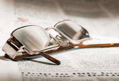 Glasses on newspaper
