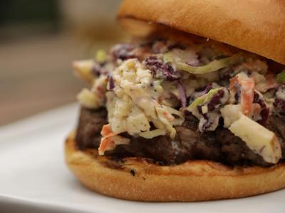 Sizzling beef burger topped with Tennessee whiskey-infused slaw: Welcome to BBQ heaven