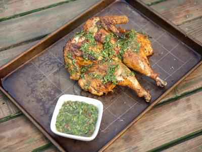 Juicy, crispy and flavorful: Grilled spatchcock chicken with chimichurri sauce