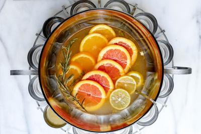 Toast the new year with this rosemary and citrus-Champagne punch