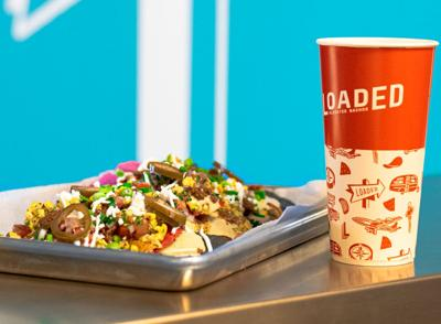Loaded: Elevated Nachos nachos and soda