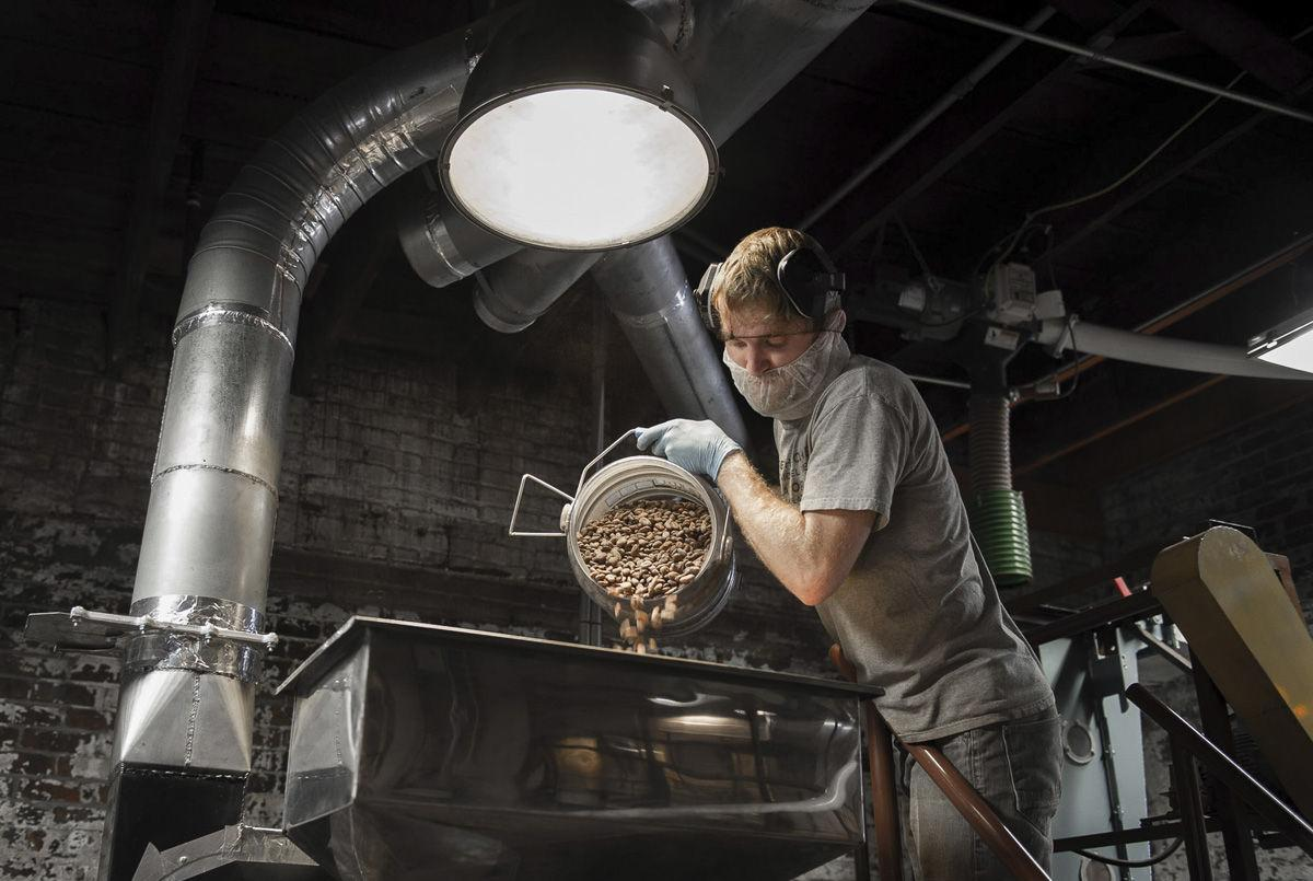 Askinosie Chocolate: Worker Pouring Beans