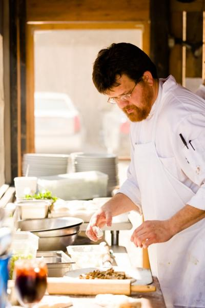 Chaumette chef Adam Lambay prepares lunch in the barn's outdoor kitchen.