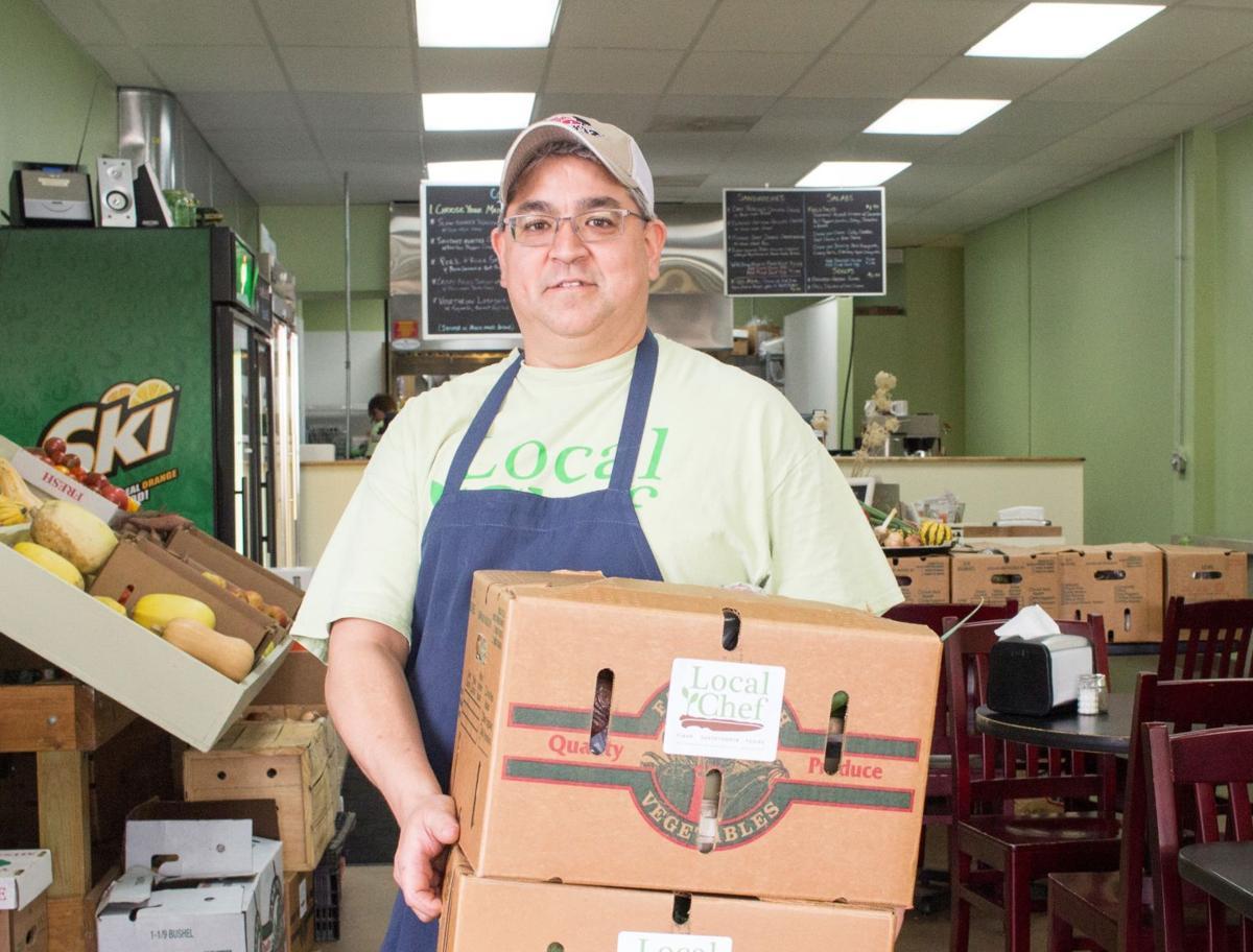 Rob Uyemura with CSA boxes