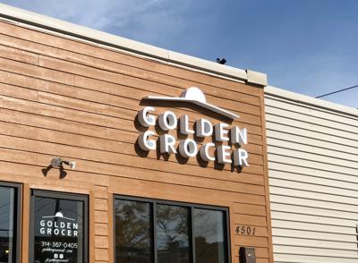 Golden Grocer sign