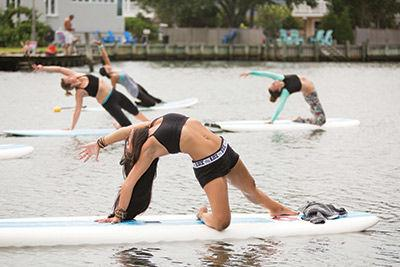 Why We Love Paddle Board Yoga (And You Should, Too!)