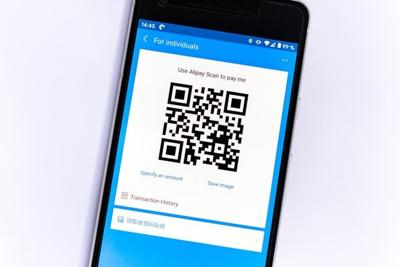How are QR codes utilized in movie theaters today?