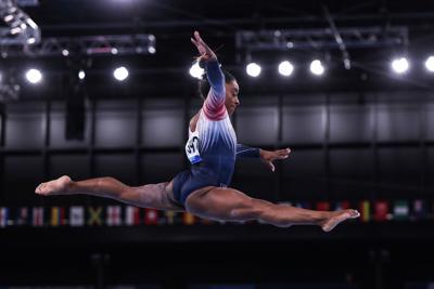 Biles bounces back; wins bronze on beam