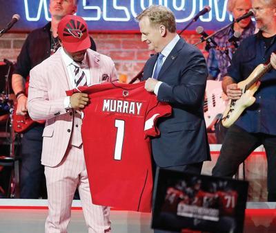 NFL commissioner Roger Goodell, middle, with Kyler Murray