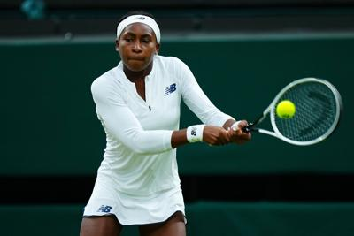n this photo from July 6, 2021, Coco Gauff of The United States, playing partner of Caty McNally of The United States plays a backhand in their Ladies' Doubles Third Round match against Veronika Kudermetova and Elena Vesnina of Russia during Day Eight of The Championships - Wimbledon 2021 at All England Lawn Tennis and Croquet Club in London, England.