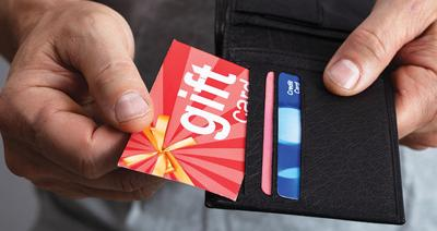 Human Hand Removing Gift Card From Wallet