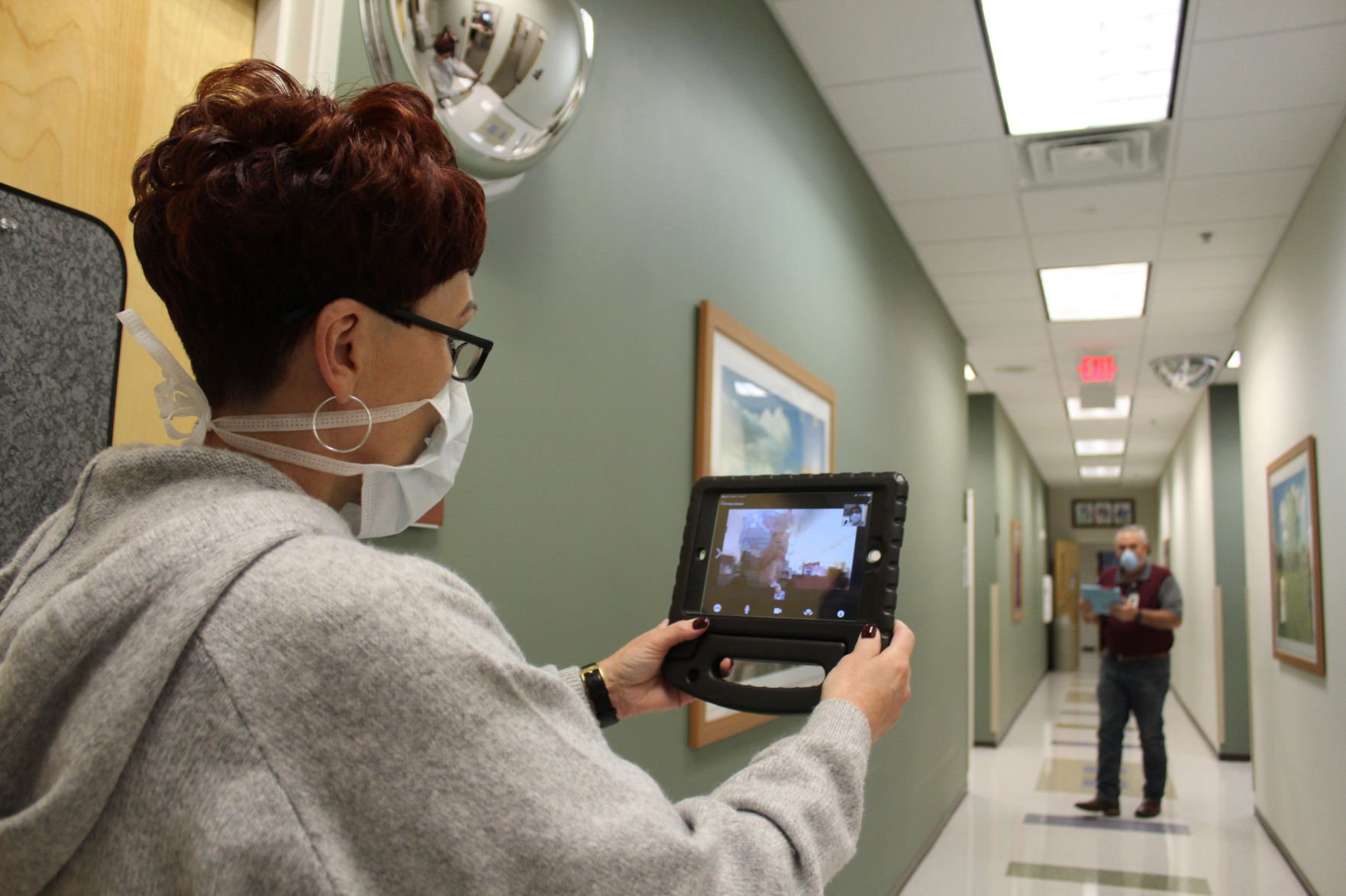 Nicole Hawkins, a health system administrator, and Ronald Twitchel, a clinical workflow analyst, show how Virtual Video Visit works, Friday, at the Killeen Medical Home, a CRDAMC health clinic in Killeen. The program allows doctors to see their patients virtually.