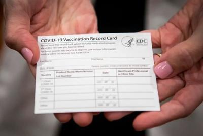 COVID VACCINE CARD TX TRIBUNE