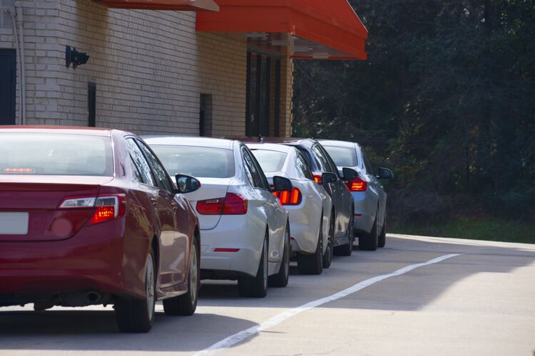 Generic drive thru pickup window 750px with cars waiting in line to get their products or food