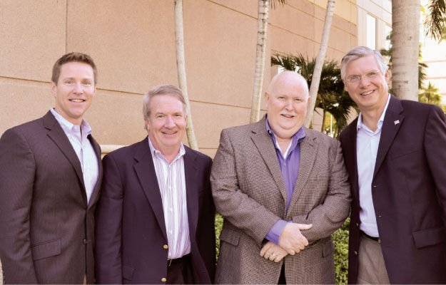 Event chair Scott Sutton, with Joe Bourdow, ValPak; Mark Johnson, Granite Transformations; and Ray Titus, Signarama.