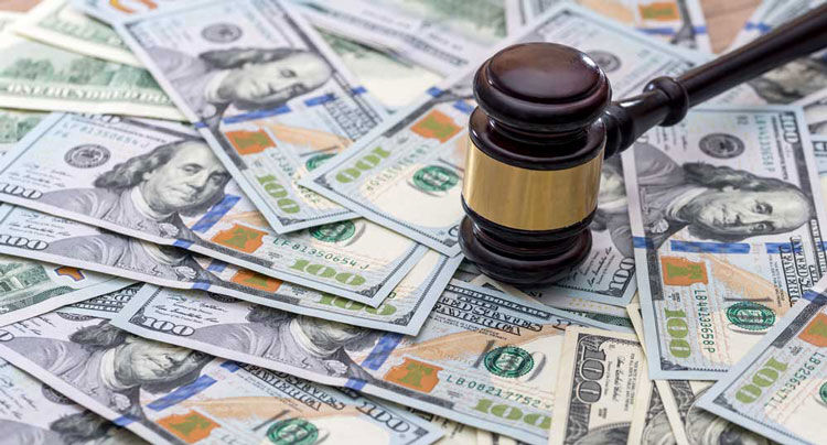 wooden gavel with usa dollar on desk. close up.