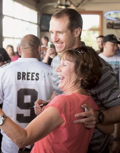 Saints QB Drew Brees suits up for his next franchise gig