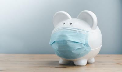 Piggy bank wearing surgical face mask. Global economy during coronavirus pandemic. Financial crisis, banking concept. saving and investment.