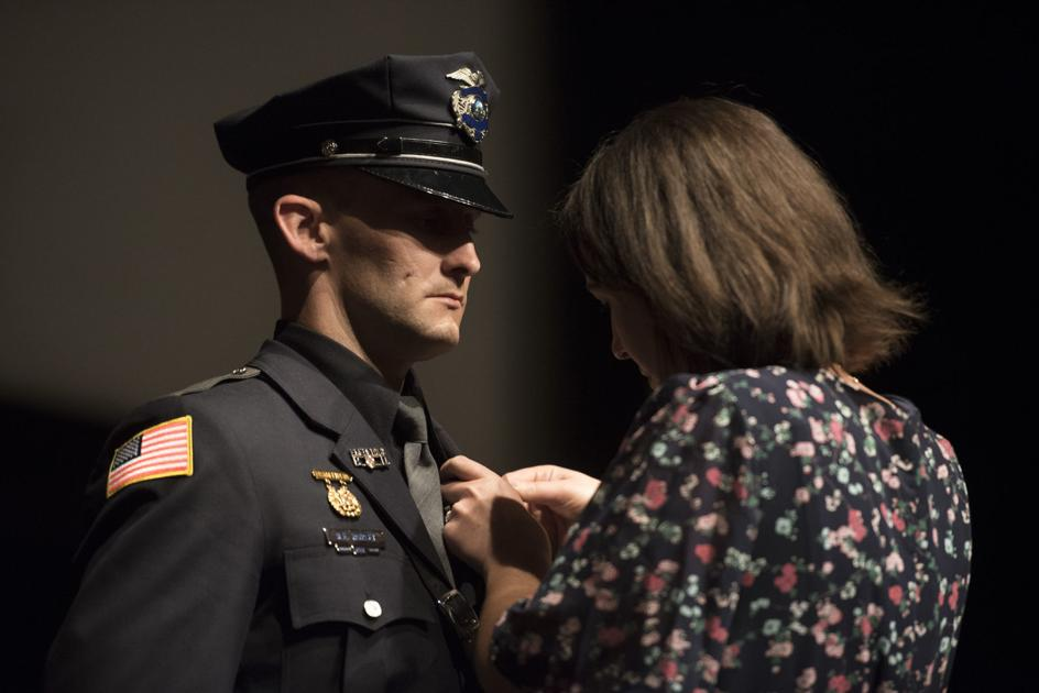 Earning the Badge: Newly sworn officers graduate from