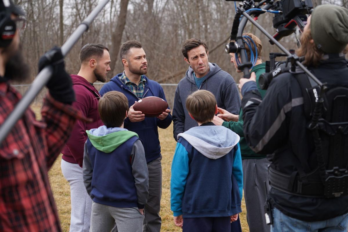 Justin, Brett, Jason football huddle (DSC03700).JPG