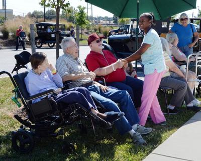 Assisted-living residents carry on despite fears about sale