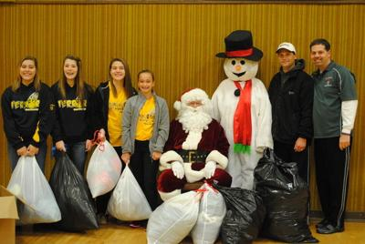 Softball team pitches in for coat drive