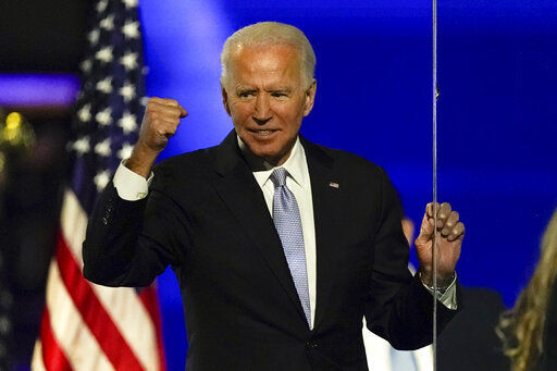 Biden promotes unity, turns to business of transition