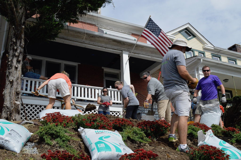 Volunteers From AstraZeneca Do Landscaping Work On A House For Homeless Men  In Brunswick On Friday As Part Of The United Wayu0027s 2017 Day Of Action.