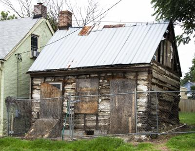 Log cabin at 107 E. Fifth St.