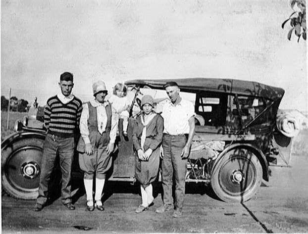 Women in front of car.