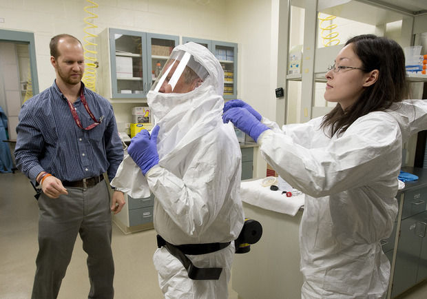 Researchers, physicians face Ebola outbreak with different rules
