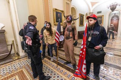 Company fires employee who stormed Capitol with badge on (copy)