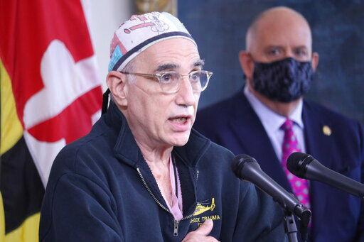 Hogan unveils new limits to fight war 'the virus is winning'