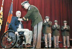 Injured officer honored: Olinger receives coveted Medal of Honor