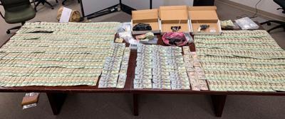 Police seize drugs, guns, cash